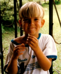 Drew age 5 with small snake in hand