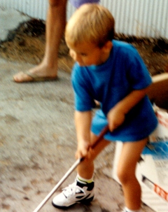 Nathan age 3 with a golf club in his hand